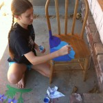 Painting her second chair