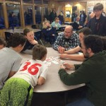 Card games in the lodge (my son is to the left of the man in the checkered shirt).