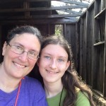 My daughter and I in front of the hermit's cabin