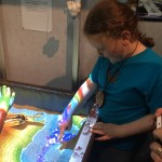My son, augmented reality sandbox in the museum