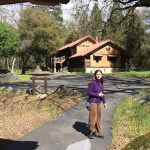 My daughter outside our cabin.